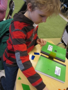 Matthew tries to create a standing structure.